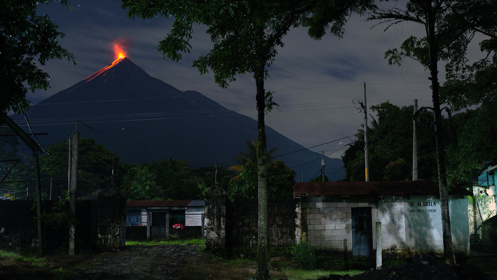 A view of the Fuego volcano erupting from the entrance to the 15 de Octubre La Trinidad community in Guatemala on 27 August, 2020