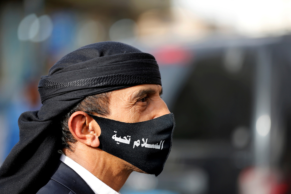 A man wears protective mask in Sana'a