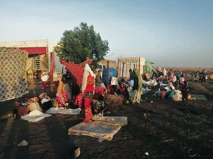 A photo of Tigrayan refugees congregating in the border town of Hamdayet, which has a small transit centre managed by the UN's refugee agency