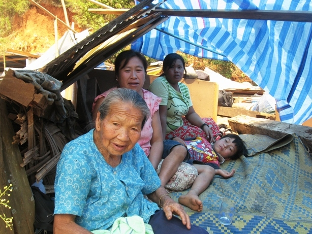 Family outside Earthquake Damaged House