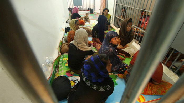 Detainees in a police station on 12 June 2019 after a fishing boat carrying more than 60 Rohingya refugees was found beached at Rawi Island in the province of Satun, Thailand, which borders Malaysia.