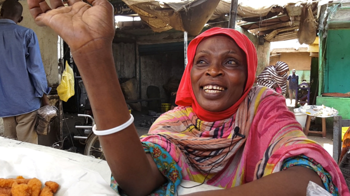 A Sudanese woman sells falafel