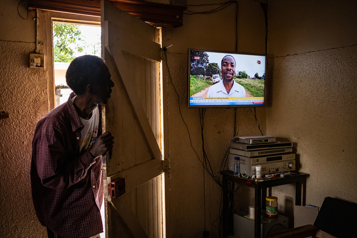 Hassan Mohammad peers at the TV at his home