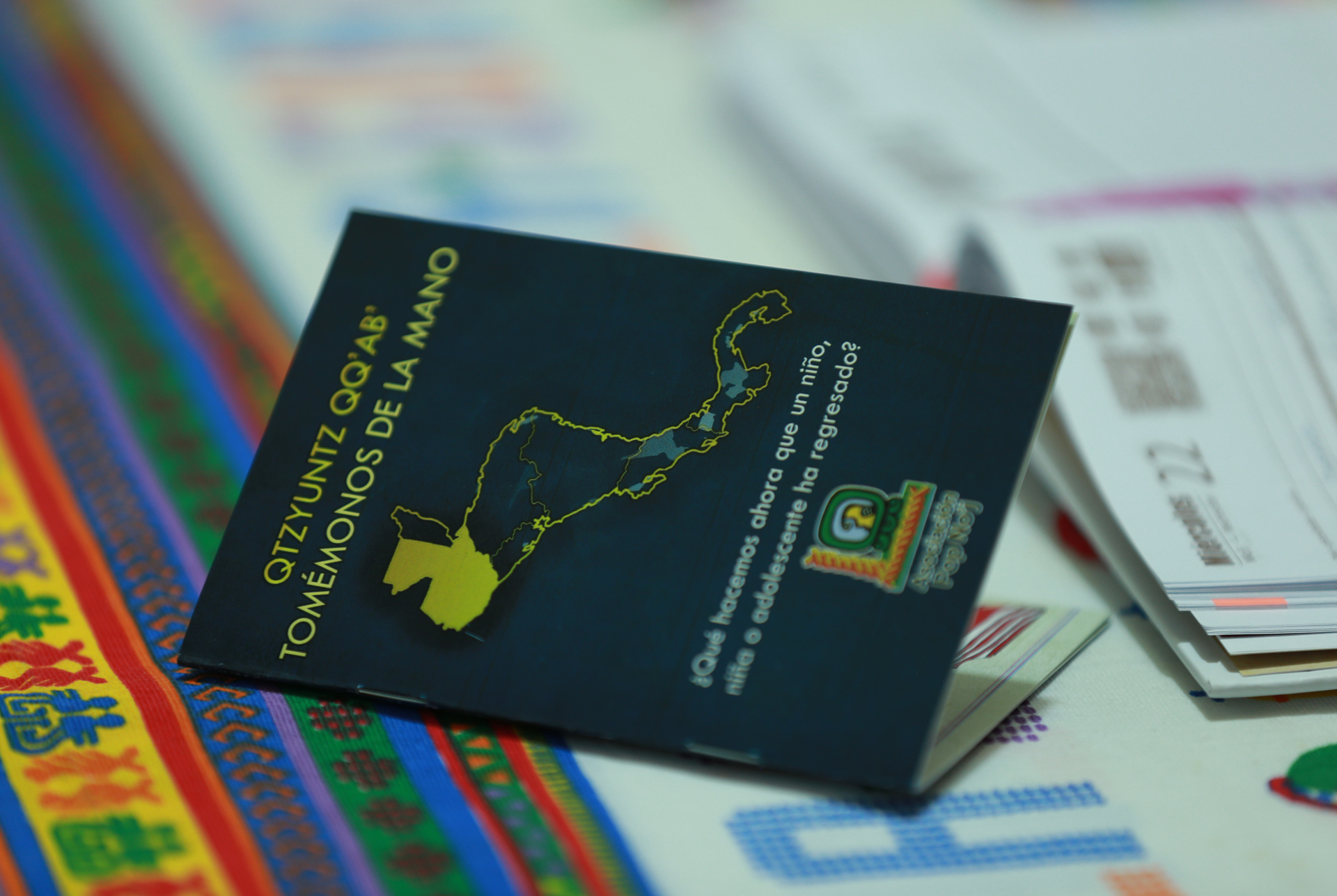 A booklet for deported children with information in Mayan languages, provided by a local NGO, Pop Noj.