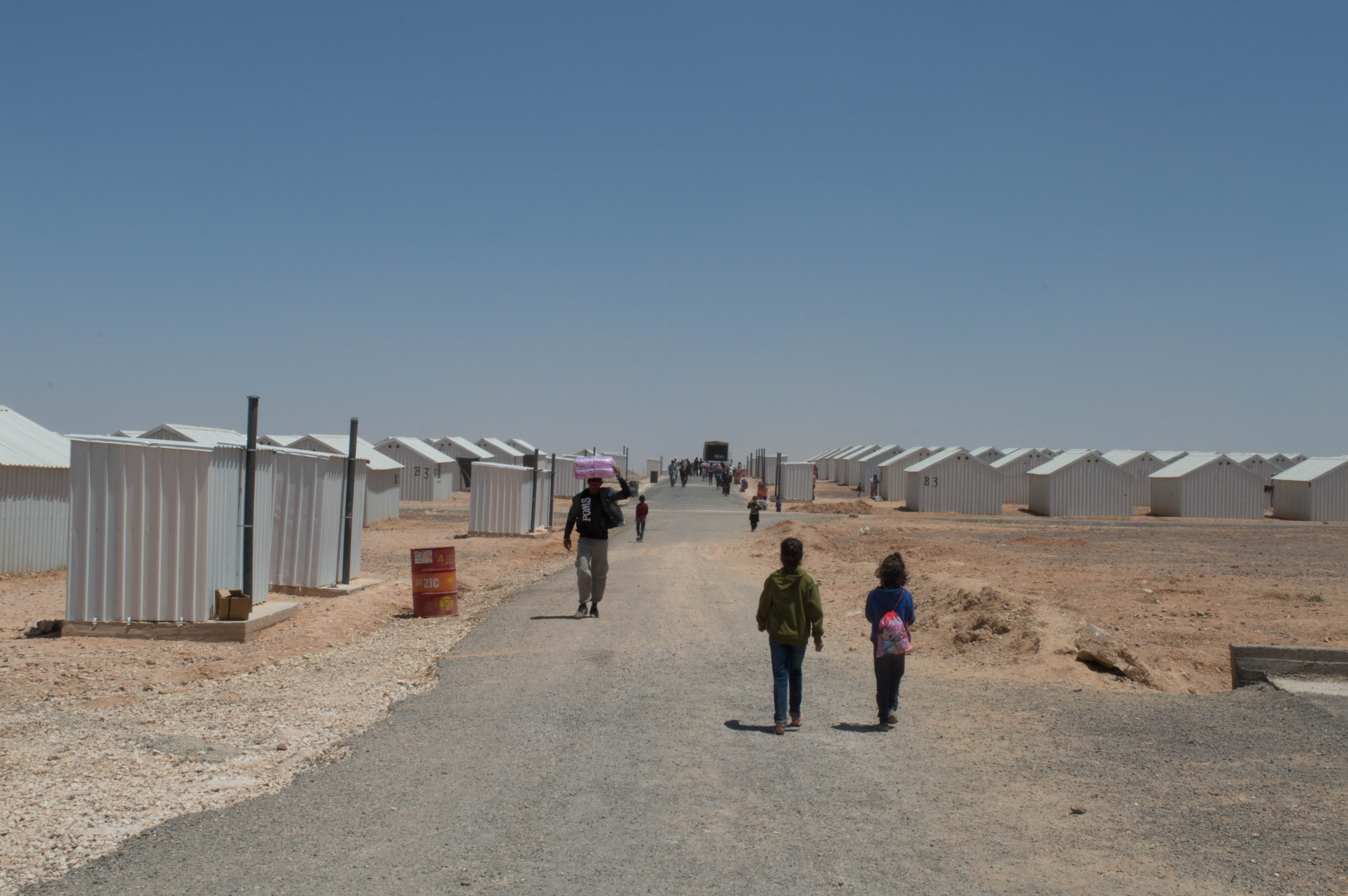 Children walking in a refugee camp
