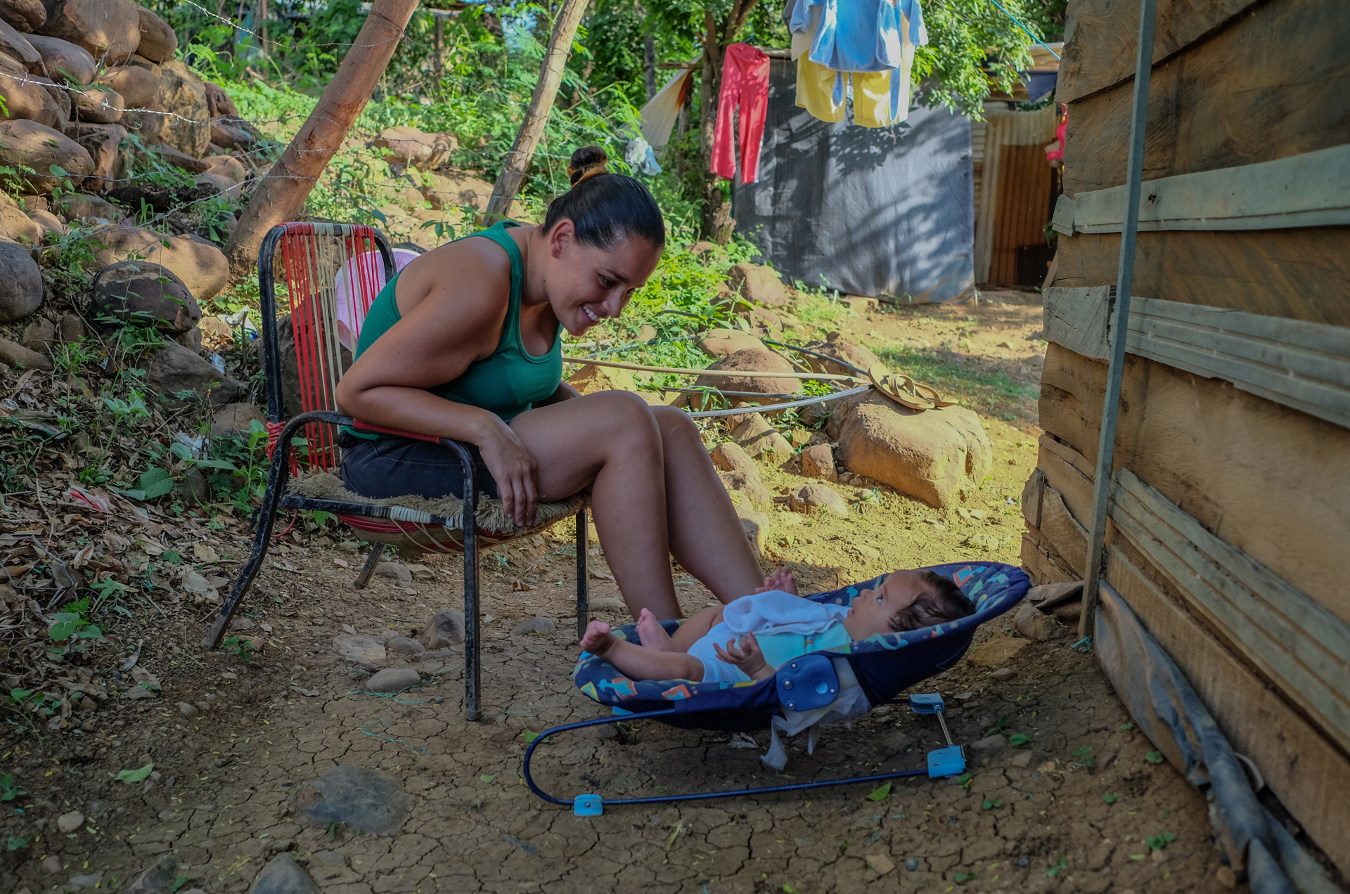 Élida Betancourt and her son Christopher outside the house in Las Delicias – owned by a Colombian – where they have been living for the past nine months. They don't pay rent, only utility bills.