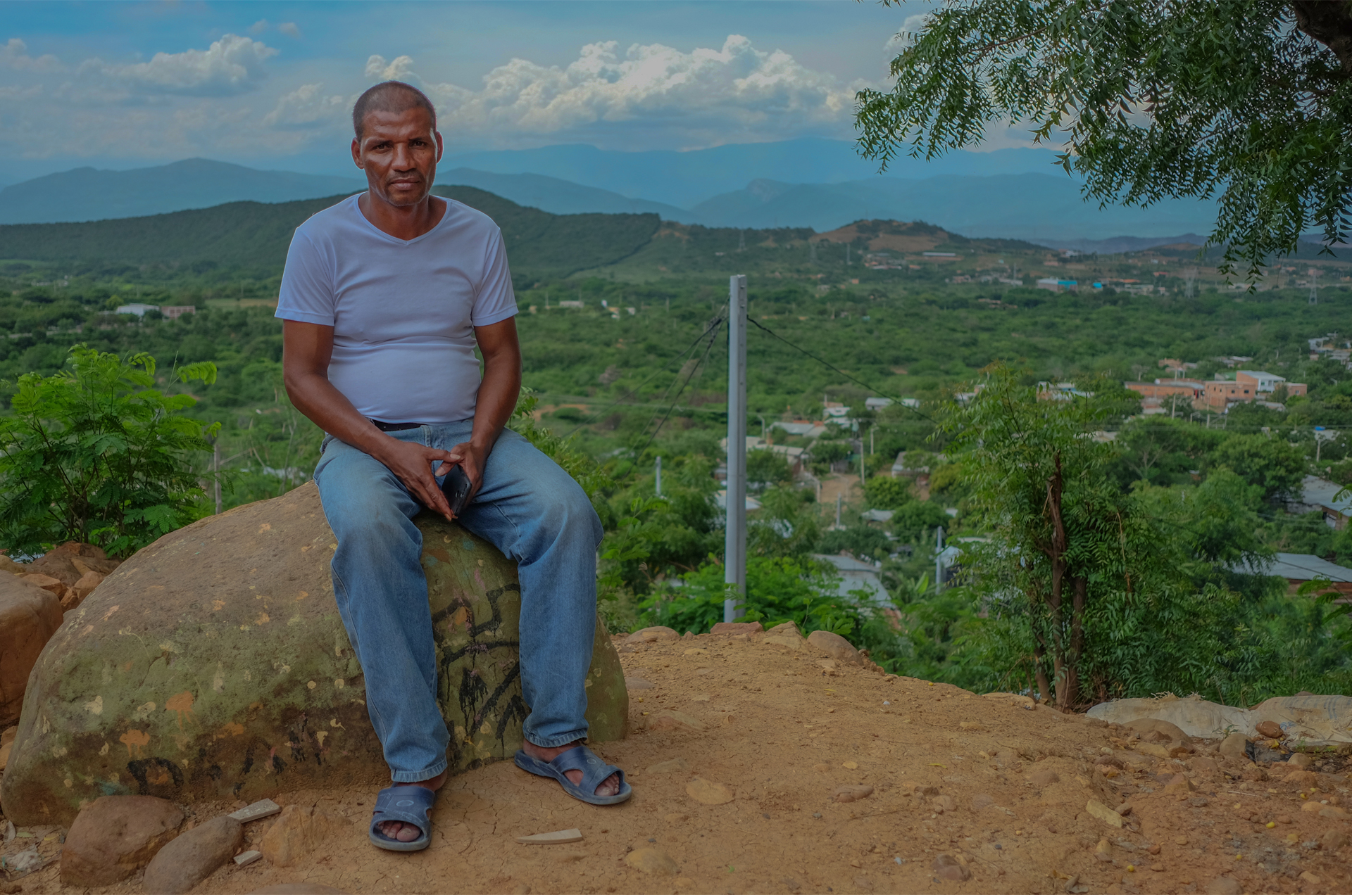 José Luis Zabaleta, Las Delicias community leader, sitting on top of the neighbourhood's highest hill.