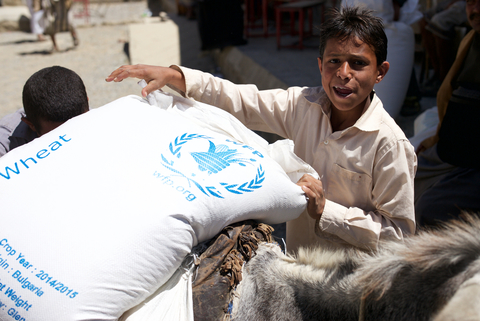 Yemeni boy with WFP food bag