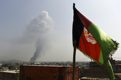 Smoke rises from the site of an attack after a massive explosion the night before near the Green Village in Kabul on 3 September 2019.