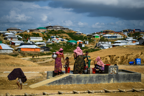 Rohingya refugees collect water at Kutupalong refugee camp in Bangladesh