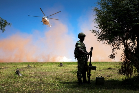 Soldier in DRC with helicopter in background