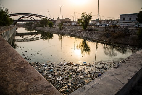 Basra water canal littered with trash, plastic and debris