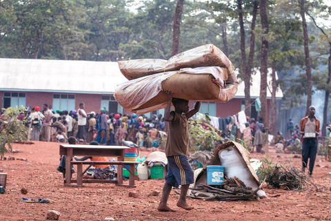 A child carries a mattress in Nyarugusu refugee camp, Tanzania.
