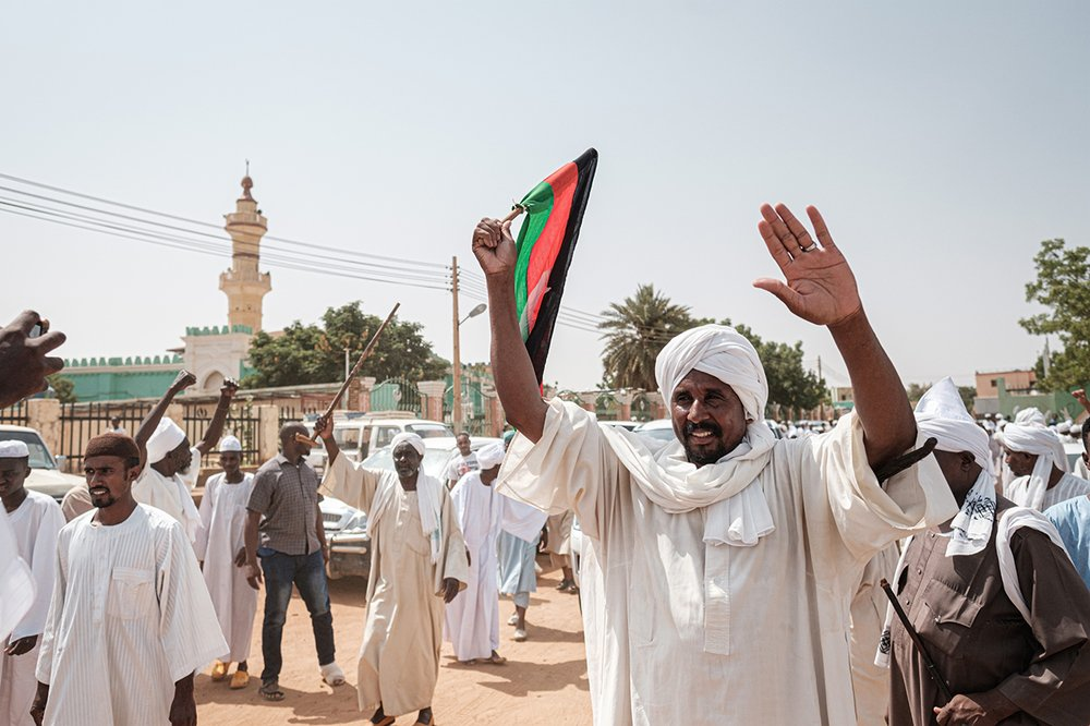 People react as they leave a mosque where Sudanese top opposition leader and former premier attended Friday prayers in the capital Khartoum's twin city Omdurman on June 14, 2019.