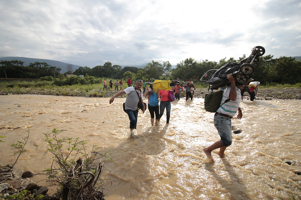 Venezuelans cross the river into Colombia on 20 November 2019.