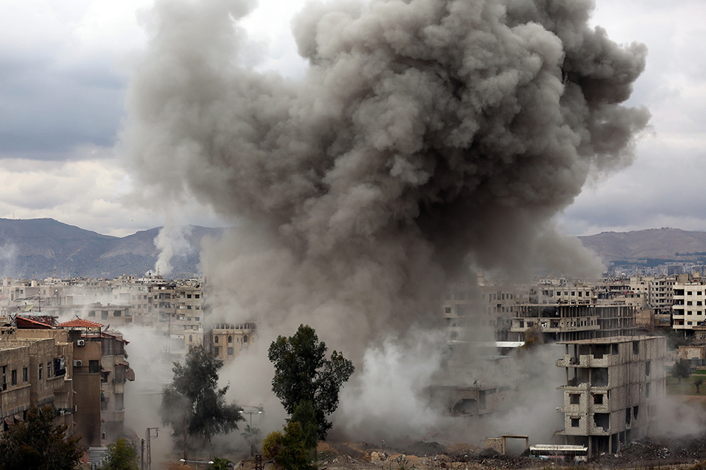 AFP PHOTO: Smoke billows in Eastern Ghouta