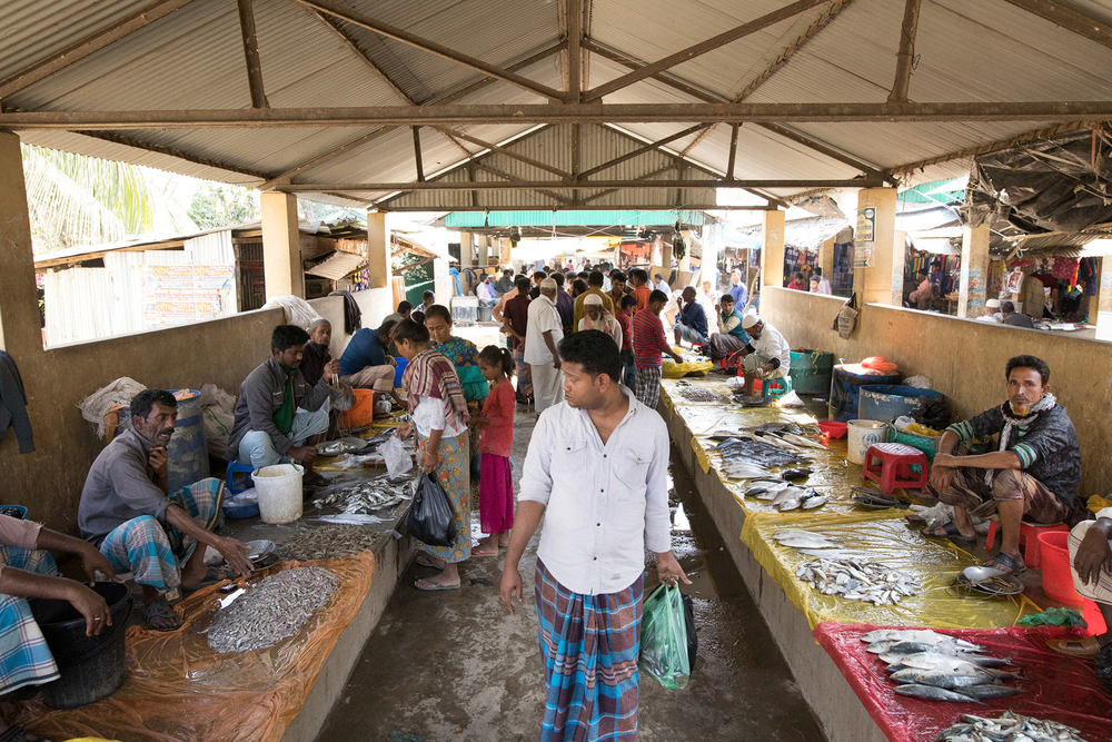 Traders sell their goods at Whykong fish market, near the Rohingya refugee camps. Income has fallen and prices have risen since the refugee crisis began in August 2017.
