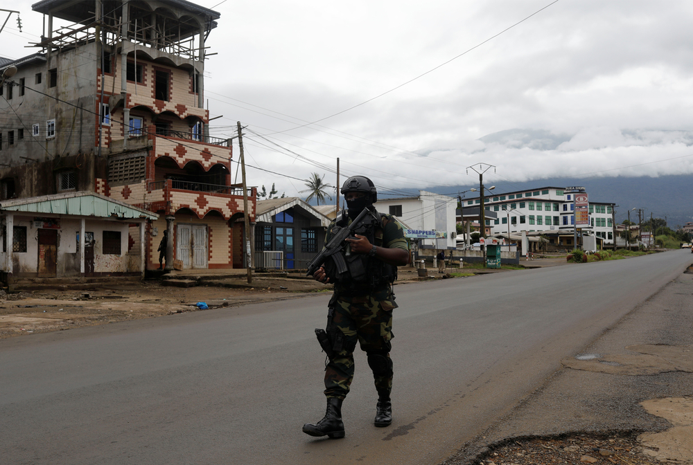 A member of the Cameroonian government's elite Rapid Intervention Battalion (BIR) walks along an empty street while on patrol in the city of Buea, capital of the anglophone Southwest Region, on 4 October, 2018.