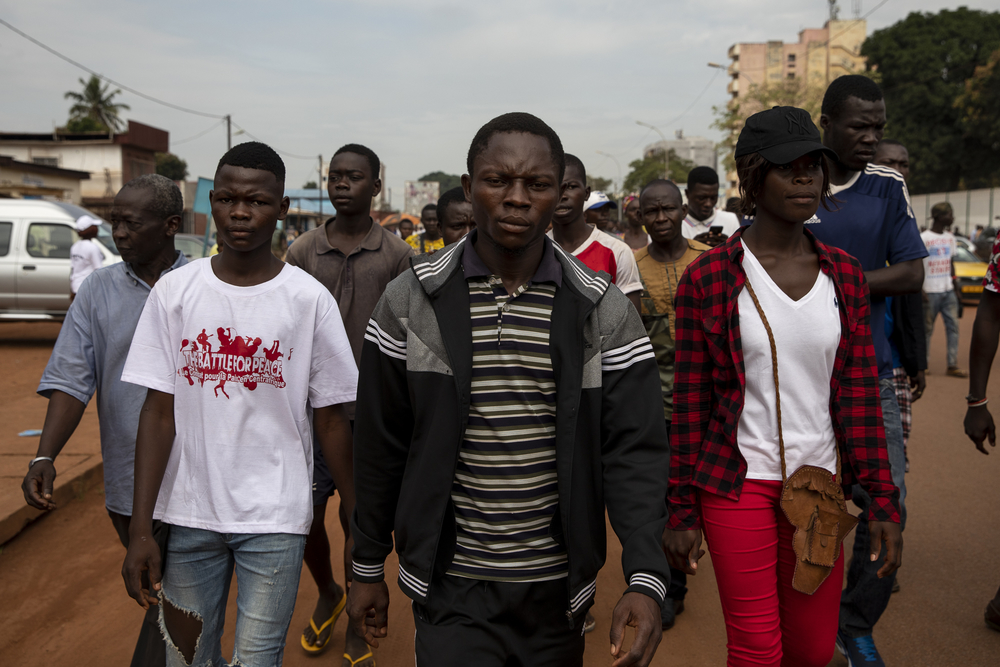 "Members of the Ë Zîngo Bîanî movement march in Bangui on 30 September to protest against the peace agreement and demand a ""return to constitutional order""."