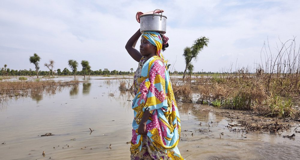 A woman walks through floodwaters in Maban, South Sudan, where large areas have been inundated by heavy rains in recent months.