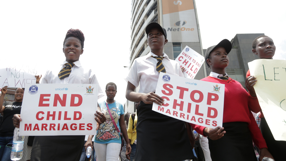 Schoolgirls in Harare, Zimbabwe, protest over child marriages.