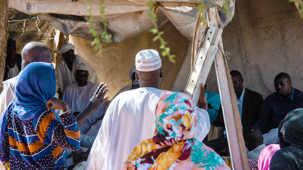 A heated meeting takes place between residents of Zamzam camp for the internally displaced in North Darfur. They petitioned the new civilian-led government in Khartoum to bring peace and democracy to their region.
