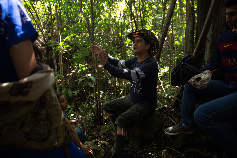 Community leader Federico Montes leads a tour of students from the University of Amazonia in nearby Florencia.