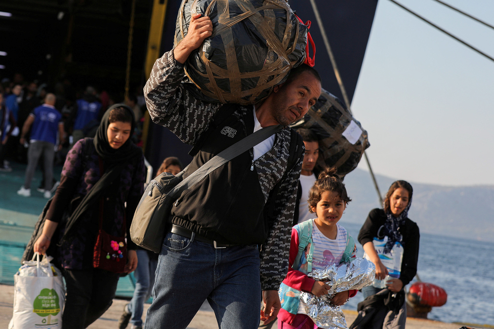 Refugees and migrants arrive in Greece, 22 October 2019.