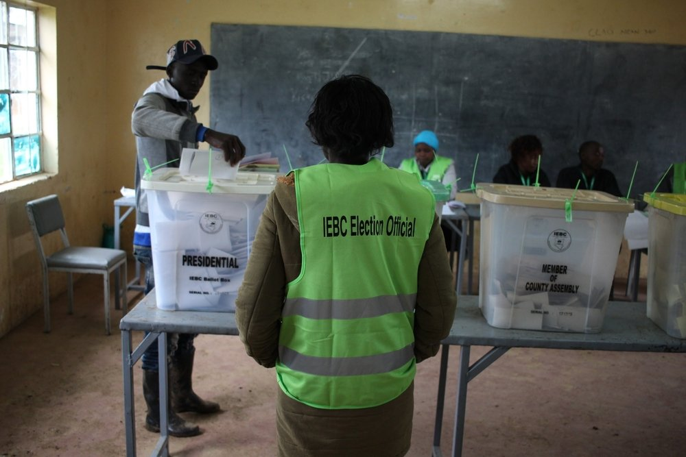 A voter casts his ballot at a polling station in Eldoret, Uashin Gishu