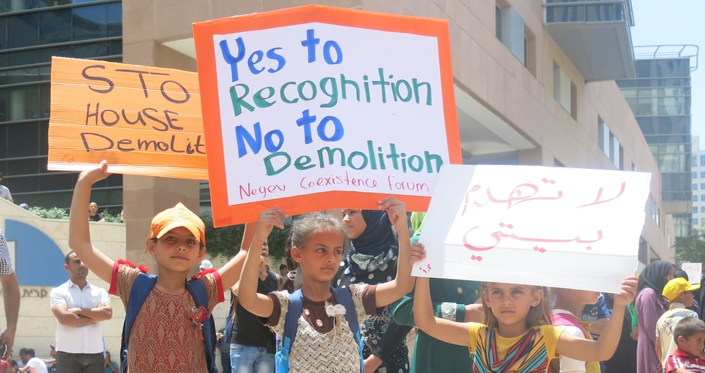 Children hold signs