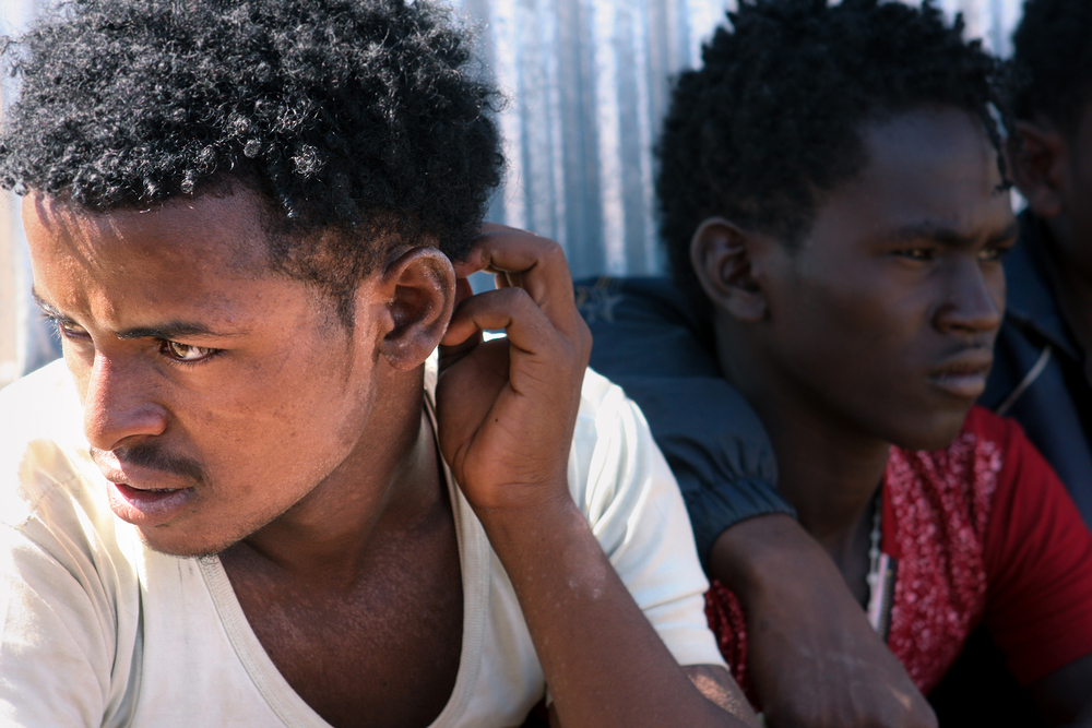 Closeup of two Eritrean men looking away from the camera