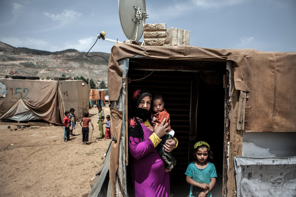An unregistered Syrian refugee family, originally from Aleppo, in an informal settlement in Lebanon's eastern Bekaa Valley
