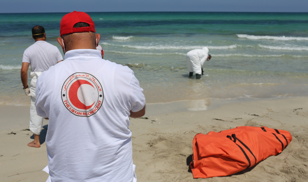 Libyan Red Crescent volunteers on beach recovering bodies