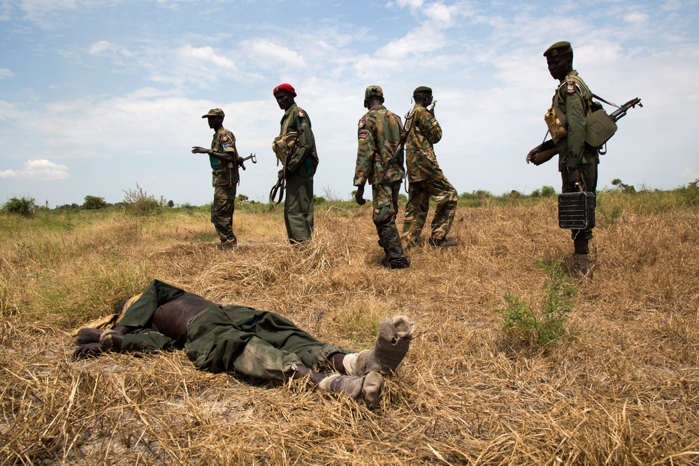 Victorious SPLA soldiers and dead rebel