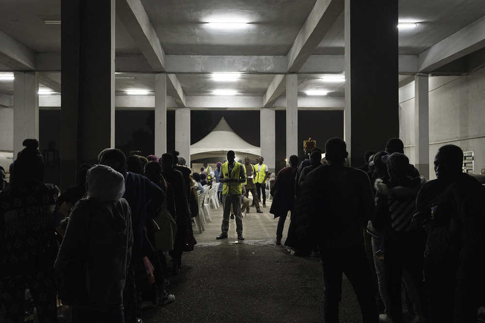 Migrants who have decided to make their voluntary return from Libya to Nigeria queuing at the airport for the triage. Lagos, Nigeria, 2020.