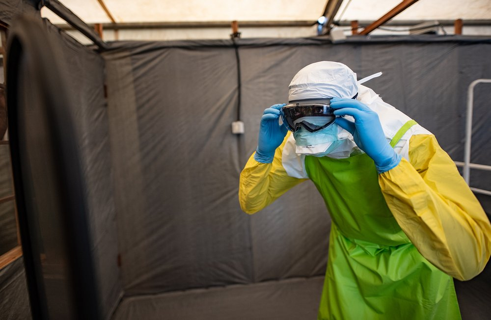 A photo of a man with protective gear in an Ebola centre