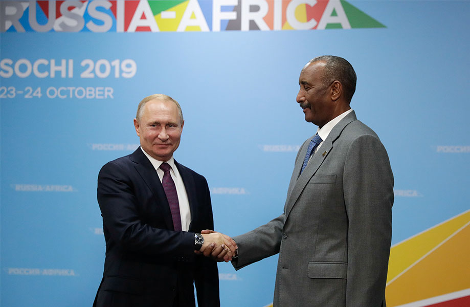 Russia's President Vladimir Putin shakes hands with head of Sudan's transitional sovereign council Abdel Fattah al-Burhan during a meeting on the sidelines of the Russia–Africa Summit in Sochi, Russia 23 October 2019.