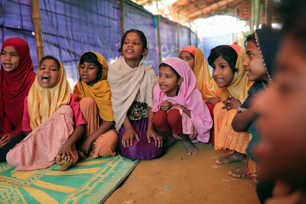 Rohingya children attend a class at an Arabic-language school in Balukhali camp on 8 April 2019.