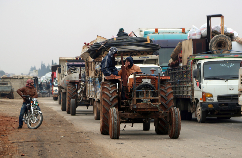 Trucks carry belongings of people fleeing from Maarat al-Numan, in northern Idlib, Syria 24 December 2019.