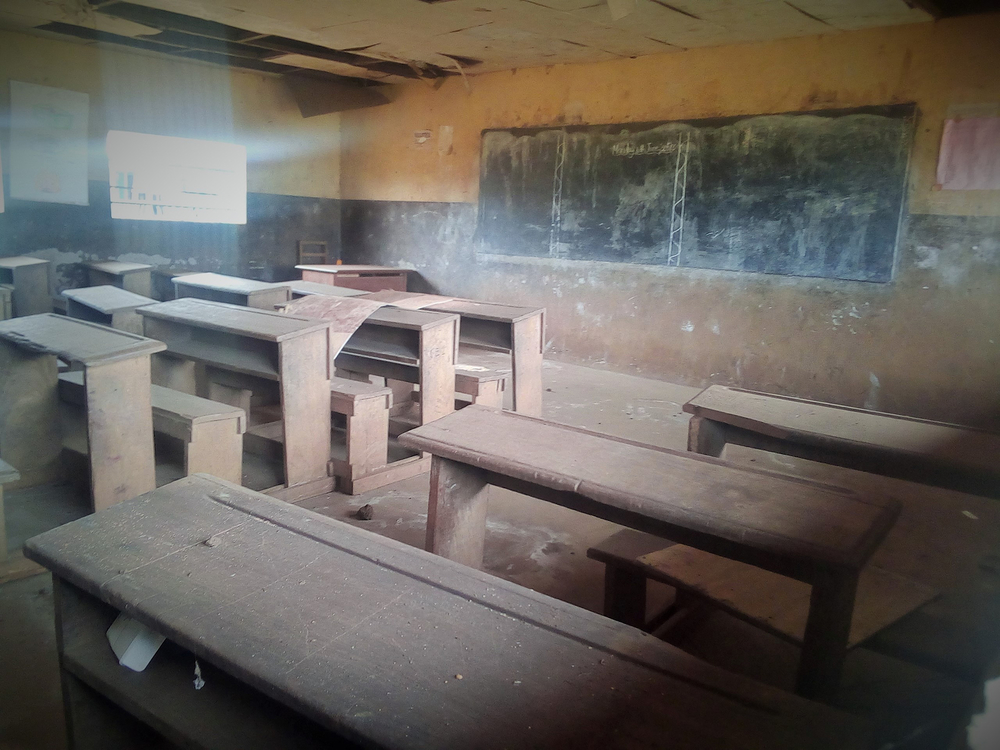 An empty, dusty classroom