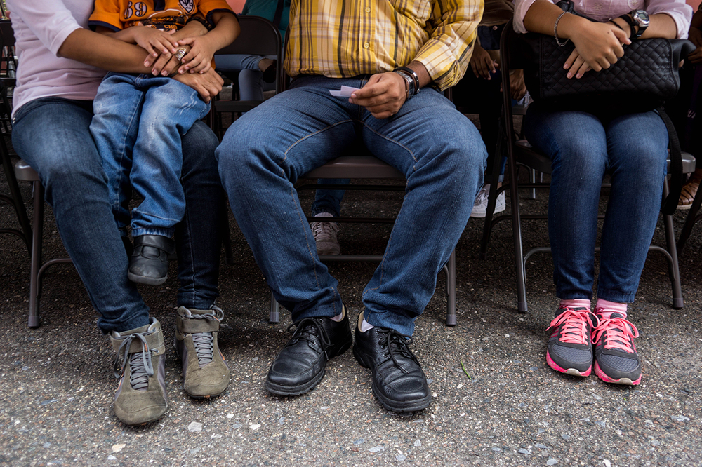 closeup of a people in jeans as they sit waiting