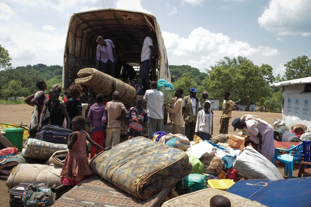 South Sudan refugees unloading at Maaji refugee settlement