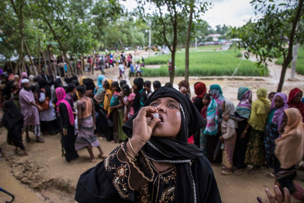 A woman drinks cholera vaccine