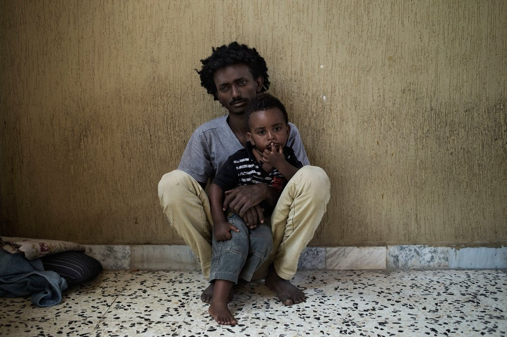 Man and his son in Libya detention centre