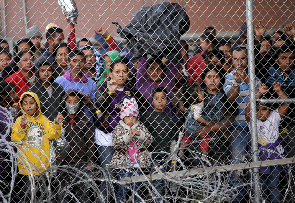 Central American migrants are seen inside an enclosure where they are being held after turning themselves in to request asylum, in El Paso, Texas.