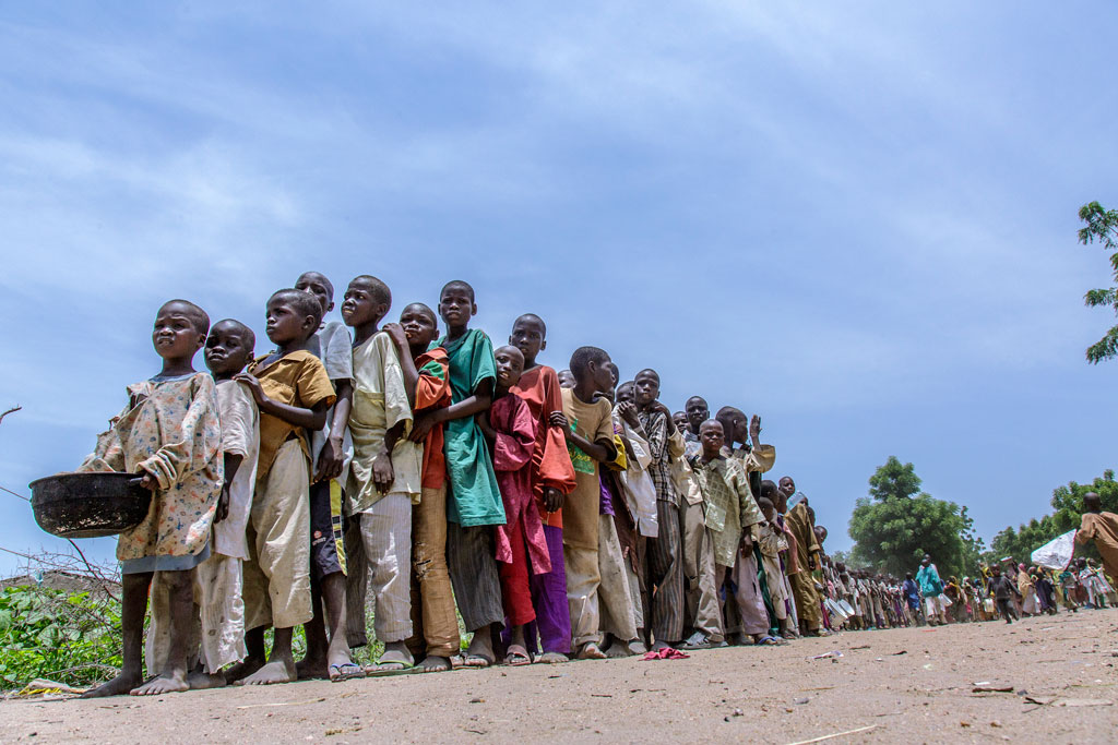 Nigerian nternally displaced children waiting for ready-to-use therapeutic food